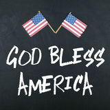 God Bless America. Note with american flags Royalty Free Stock Photography
