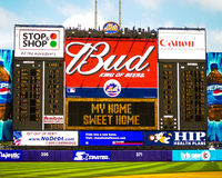 God Bless America, Shea Stadium scoreboard. Center field scoreboard at Shea Stadium posts the lyrics to God Bless American, sung during the 7th inning of a Royalty Free Stock Photo
