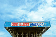 God Bless America. A God Bless America Sign on end of a Building Roof Royalty Free Stock Image