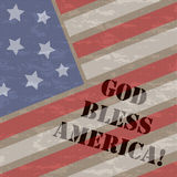 God Bless America 4th July Background. 4th July Stars and Stripes grunge background with stencil style text reading God Bless America on a rough fabric texture stock illustration
