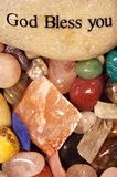 God Bless You. Healing stones and crystals with God Bless You displayed on stone stock images