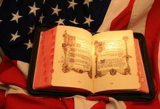 God and country 6. Open bible on flag using warm light to highlight text Stock Images