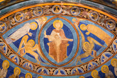 God Father on his throne.  Romanesque fresco from the 1200s in bright ultramarine color. Shining ultramarine wallpainting in Bjaresjo church, Sweden Royalty Free Stock Images