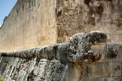 God feathered serpent mayan kukulkan quetzalcoatl. On the field for playing ball. Chichen Itza. Mexico Stock Photo