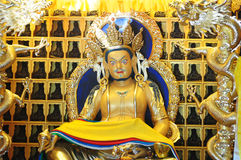 God of fortune. Golden statue of the God of fortune in a lamasery Royalty Free Stock Photography