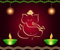 God Ganesha. Indian God ganesha with lit lamps Royalty Free Stock Image