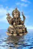 God Ganesha on water. Hindu God Ganesh over de water whith a blue sky Royalty Free Stock Photos