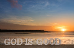 God is Good Lagoon. 3D words saying `lGod is good` as the sun goes down into clouds over a river lagoon Stock Images