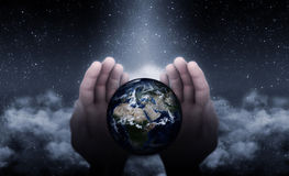God Hands On Earth. Hands of God protecting and blessing the Earth Royalty Free Stock Images