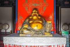 God of happiness Hotei in the temple Royalty Free Stock Image