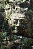 Face in Angkor Wat. God head  in the temple of Angkor Wat Stock Photography