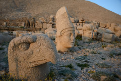 God heads on Nemrut Dag necropolis. Some of the statues near Mount Nemrut (Turkey). West Terrace: heads of God Apollon, Goddess of Kommagene (Tyche) and God Ptah Royalty Free Stock Photography