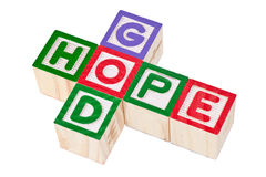 God and hope. Wooden blocks forming the words god and hope isolated on white background Royalty Free Stock Photo