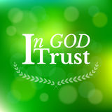 In god I trust typographic. On green bokeh background and wreath Stock Photos