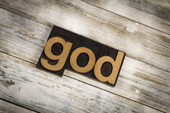 God Letterpress Word on Wooden Background Stock Image