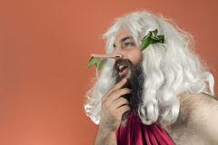 God Liar. God stroking beard and telling many lies as his nose grows Stock Images
