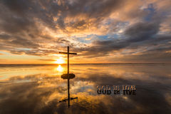 God is Love Beach. Cross on a beach at Sunset, with a wonderful reflection and the word God is Love Stock Photos