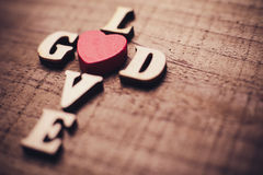 God is Love. Concept text lying on the rustic wooden background Stock Photography