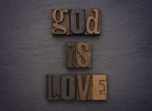 God is love. Spelled out in type set on a chalkboard Stock Photography