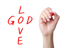 God is love. Hand Writing God is Love concept isolated on white background Royalty Free Stock Images