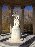 The God of Love. The statue of Cupid as the centerpiece of the Love Monument in the English Gardens, Petit Trianon, Chateau de Versailles, France Stock Images