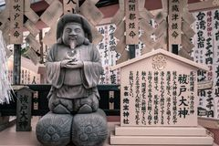God of love statue at Jinja-Jishu shrine inside Kiyomizu-dera Temple in Kyoto. Okuninushi -god of love- statue at Jinja-Jishu shrine inside the famous Kiyomizu stock photo