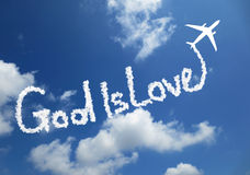 God is love. ! text in clouds form with blue sky background royalty free stock photography