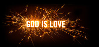 God Is Love title on dark background. Design of sparkly glowing title card for God Is Love on dark background Stock Photography