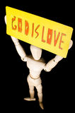God is love. Wooden model show God is love in darkness Royalty Free Stock Photos