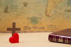 For God so loved the world. A Cross on a rustic world map stock photography