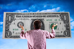 The god of money - materialistic world. Economic crisis - capital market - uncertainty Stock Image