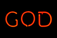 God neon sign. Red neon sign of the word 'God' on a black background Royalty Free Stock Photo
