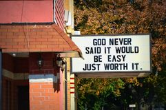 God Never Said it Would Be Easy Just Worth It. A church sign in downtown Delevan, Wisconsin that says God Never Said It Would Be Easy Just Worth It. Its on the stock photos