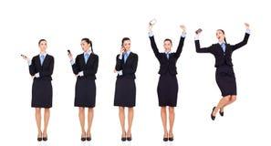 god nyheterna för affärskvinna över den mottagna telefonen Arkivfoto