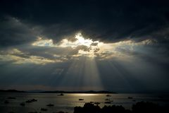 GOD RAYS OVER THE SEA royalty free stock photos