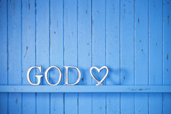 God Religion Christian Love Background. A blue painted wood background with the word God on it and a love heart stock image