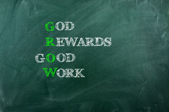 God Reward Good  Work. GROW acronym God Reward Good  Work , written with  chalk on blackboard Royalty Free Stock Image