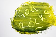 God Rocks etched in colored painting stock photo