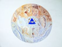 God`s all-seeing eye. Fresco on the facade of Saint George church in Luson, Italy royalty free stock photography