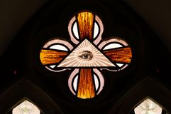 God`s all-seeing eye. Stained glass window in Cistercian Abbey of Bronbach in Reicholzheim near Wertheim, Germany royalty free stock photos