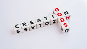 God's creation. Text ' gods ' and ' creation ' wiuth letters in uppercase and arranged crossword style with common letter ' o '  bright background Royalty Free Stock Photo