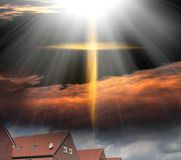 God`s cross . The Cross of Jesus Christ and beautiful clouds . Light in dark sky . Religion background . Dramatic nature background stock images