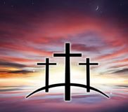 God`s cross . Light in dark sky . Religion background . stock image