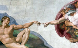 God's finger. Touching Adam hand. Adam creation by Michelangelo