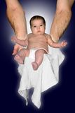 God's Greatest Gift. Arms handing a baby down Royalty Free Stock Images