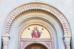 God's image mosaic above the doorway of a church. God's image mosaic above the doorway of an old church Stock Photos