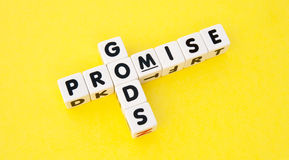 God's promise. Text ' promise ' and ' Gods ' inscribed in black uppercase  letters on small white cubes and arranged in crossword style  with common letter ' o Stock Photography