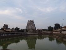God's Residence. Temple tank with a huge tower and n the backdrop at Chidambaram, the temple town of Tamilnadu where God Shiva is believed to be playing cosmic stock images