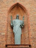 God sculpture on catholic church wall, Lithuania stock photography