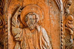God sculpture in wood. On a Christian door church Stock Photos